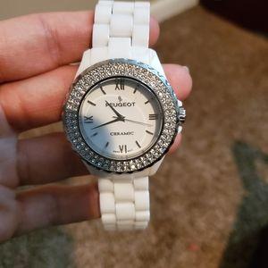 White ceramic Peugeot watch w crystal bezel